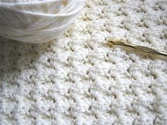 Easy blanket stitch. It is just sets of 3 stitches, one single crochet and two doubles. You can change colors after a few rows for a multicolored effect.