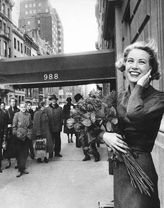 Grace Kelly poses just off of Fifth Avenue in New York, March 1956.