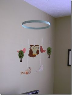 DIY Owl Mobile for baby. Hobby Lobby has tons of pre-painted shapes. You could do this for any theme.