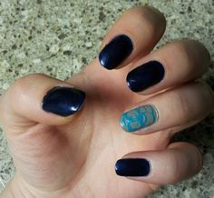 Navy and grey Mani. Use a straw to make the circle pattern on the accent nail