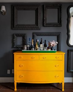 Home bar on painted yellow dresser