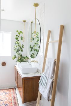 Nothing like a storage ladder and large circle mirror in the bathroom.
