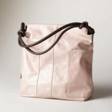 This zip-top slouch tote bag is lustrous in finely crafted leather.
