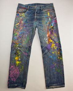 Denim Refinery splatter jeans...this company modifies your old pair the way you request: http://denimrefinery.com/dr/d-defined/