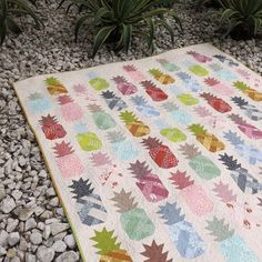 "Quilt and Pillow Pattern by Elizabeth Hartman Use your favorite fat quarters or 10"" fabric squares to piece these sweet patchwork pineapples! Pattern includes instructions for 3 quilt sizes and a 20"""