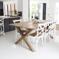 Wooden table (but bigger) with cross back chairs. The black ones maybe? Parquet table would be awesome