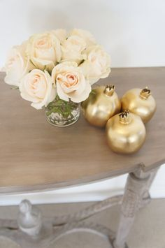 A set of three gold pomegranates by prettypleasedesign on Etsy, $25.00. Sofreh Aghd Styling + Design by Pretty Please.