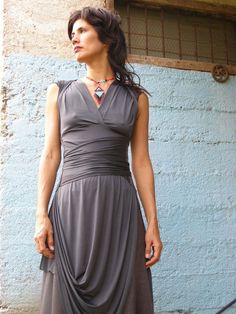 A great deep v neck dress  With BAT SLEEVES, that can be folded   backwards and closed with a hook..  Creating a unique Diamond shape back cleavage