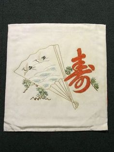 This is a vintage Fukusa with flying cranes on fan and pine tree embroidered design. It also has a large kanji character 'KOTOBUKI'(means celebrate, longevity, and best wishes) with kanoko dots embroidered design