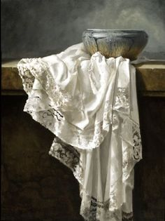 ceramic bowl w/ border-laced cloth. still life.