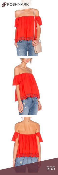 NEW Lovers & Friends red orange top! Size S Never been worn! Lovers and Friends x Revolve life's a beach top in Red/Orange!  Size Small.Short sleeves. Relaxed silhouette. Scalloped hem. Rayon/viscose. Polyester lining. Has very small snag. Look at last photo before purchasing. Lovers + Friends Tops Blouses
