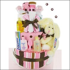 The Neapolitan = Oh how sweet. This adorable Neapolitan diaper cake is designed with modern essentials for the new baby girl. This popular theme for babies will surely be a hit at any baby shower. This gift comes wrapped with matching ribbons!   WWW.LEEANNA.LABELLABASKETS.COM   #WeGiveBack #LeeannasLaBellaBaskets #giftstore #giftshop #personalizedgifts #freepersonalization #flowers #freshflowers #freshflowerbouquets #candles #cookiebouquets #plantablegreetingcards #giftbaskets #petgifts…