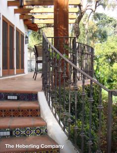 Guest house with Spanish tile and custom iron railings.