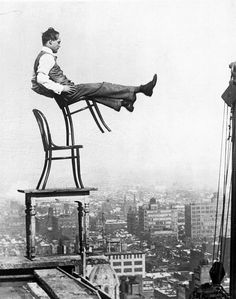 A daredevil balances on the back legs of a chair atop other furniture 20 stories up in New York circa 1920. http://ift.tt/2hAHVuJ