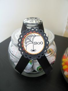 use a ribbon for a bottle topper!  attach a spellbinder die cut and voila!  cuteness