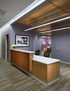 A violet-inspired color palette and local imagery surround the birthing unit nurses' station inside the women's health center Medical Office Design, Healthcare Design, Office Interior Design, Office Interiors, Reception Desk Design, Office Reception, Reception Counter, Reception Areas, Roof Repair Cost