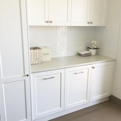 We used the same cabinetry and handles in our laundry as our kitchen with simple subway tiles and laminate benches. Pull out laundry drawers are a lifesaver - 3 boys = never ending washing 😩 #ourhamptonstyleforeverhome #hamptonstyle #classicstyle #laundry