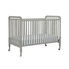 I really dig how this converts into a day bed! Too many dang decisions! DaVinci Jenny Lind Stationary Crib in Grey - buybuyBaby.com