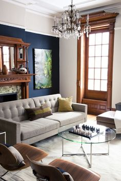 "the navy wall, the window, love the moulding and how contemporary furnishings were used in an old house. Keeps it from becoming too ""granny"" . Biddy Craft"