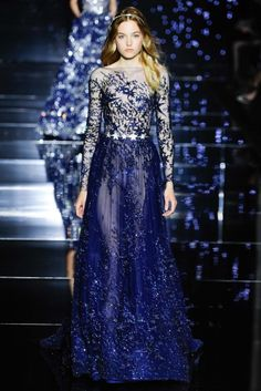 From star-jeweled belts to a stunning wedding dress, learn why we were enraptured with Zuhair Murad's Fall 2015 Couture collection.