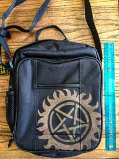 Supernatural Messenger Bag. This is what you're going to send Amanda it school with.