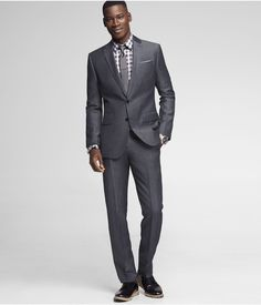 We love the slim look of the Photographer Suit. #Express