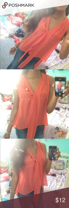 SUPER CUTE✨ coral sleeveless blouse SUMMERY TOP!!💛 the color is coral , button down, has a string in the middle so you can make a bow in the front , size small Forever 21 Tops Button Down Shirts
