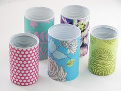 Mod Podge fabric onto cans. I use to do this when I  was little....great idea..
