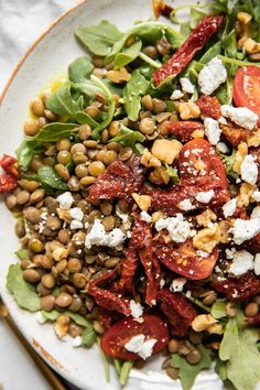 Sweet, sun-dried tomatoes, creamy goat cheese, savory lentils, fresh arugula, and fresh tomatoes. All topped with a wholesome Turmeric Ginger Dressing! Perfect for a small summer gathering with friends or as an easy, inspired weeknight meal. This easy-to-make arugula lentil salad is full of summer flavors that truly make it NEXT LEVEL! Chicken Fajita Casserole, Lentil Salad, Roasted Potatoes, Arugula, Fajitas, Weeknight Meals, Lentils, Salad Recipes, Stuffed Peppers