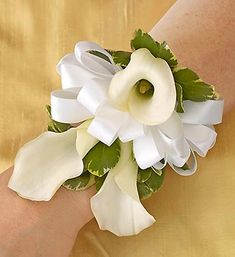 All White Corsage- graceful miniature white Calla lilies, accented with variegated pittosporum $25.00