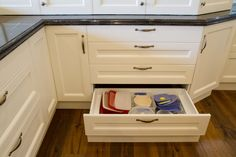 Integrated kickboard drawer allows for maximum depth for the drawer above. www.thekitchendesigncentre.com.au