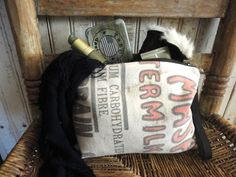 VINTAGE GRAIN SACK POUCH - This pouch was made from a very old antique grain sack displaying original print and lots of wear and character! The pouch has a removable black leather wristlet strap with antiqued brass hardware and a heavy duty YKK metal zipper with DHR style pull also in antique brass. The interior is black linen. It measure approximately 10 x 7.5, makes a great utility pouch, make up bag, pencil case or clutch!  ** All bags are made with great care in selection of materials…