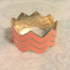3 Pink and Gold Chevron Boutique Bangles  (3) Pink and gold chevron bangle bracelets. Never worn. Comes with all 3 Boutique Jewelry Bracelets