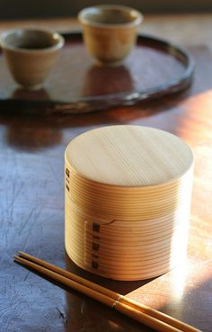 Wappa - a traditional japanese craftwork. they bend thin slices of cedar in round shape and staple the edges by small pieces of cherry bark. because it is made of wood, it keeps moisture in rice in the best balance, as well as keeping food from decay. 曲げわっぱ