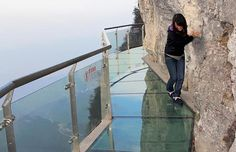 Don't look down! 5000 Feet High Glass Plank Road In China