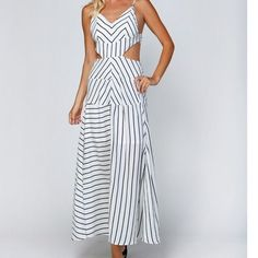 Stripe Print Cutout White/Black Stripe Maxi BEAUTIFUL Woven open shoulder maxi dress.All over stripe print.Adjustable spaghetti straps.Padded bodice bra.Side cutouts.Invisible zipper at back. Elastic backline. Fully lined. Comment on size & Ill create a listing  Dresses Maxi