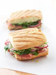 Red White and Green Panini - Filled with an assortment of meats, cheeses, and greens, an electric sandwich press or indoor grill adds the finishing touch to the ciabatta or Italian bread.