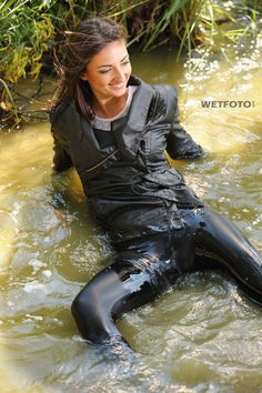 https://flic.kr/p/A8f3K6   wetfoto - girl soaked in black leggings and jacket   All 80 photos are here - wetfoto.com
