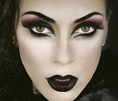black lipstick, dramatic black and red eye makeup, graphic brows