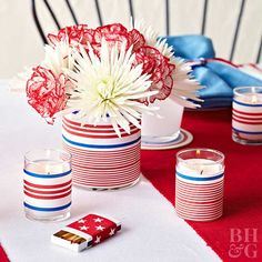 Dress up a plain glass votive holder with ribbon. Use hot glue to secure festive ribbons to the glass, then put one votive at each place setting. The same trick can be used on glass flower vases.
