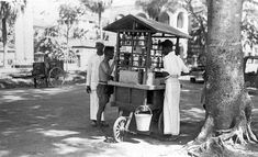 STREET HAWKER outside the Cathedral of Good Shepherd, SINGAPORE - 1930s
