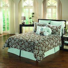 Traditional American style blue and brown comforter set with floral pattern.