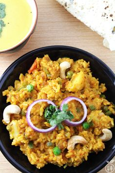 Healthy Vegetable Masala Khichdi is one-pot rice dish which is prepared with rice and different king of lentils. It is also known as Vegetable Moong dal. Veg Recipes, Indian Food Recipes, Vegetarian Recipes, Cooking Recipes, Vegetarian Dish, Healthy Recipes, Recipies, Indian Foods, Masala Khichdi