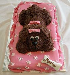 Brown puppy - I made this for my daughter's 8th birthday. She wants a real dog, but her dad is allergic, so this will have to do! :) Bed is 2 12-inch square 2-inch layers of strawberry cake, torted and filled with lemon cream cheese filling. It is covered in MMF and details are done in royal icing. Dog is yellow cake with chocolate cream filling, chocolate buttercream fur and MMF details.