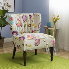 Create a vivacious display in your home with this Tori chair upholstered in an exciting floral pattern. You'll love the unique channel back and armless design, complete with espresso finished legs.