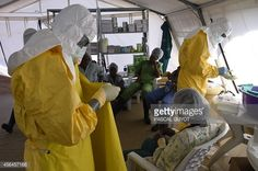 News Photo : Health workers in protective suit put their...