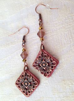 These earrings are handmade from polymer clay and are accented with copper color filigree piece.    Dimensions (approx):  Total length is 2 3/4