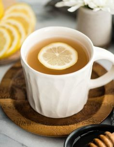 """Immune Boosting Tea Recipe is a home remedy that will boost your immune system, fight colds, ease a sore throat and calm your cough! I call it the """"magical elixir"""" because how effective it is at relieving pesky cold and flu symptoms! Detox Juice Recipes, Tea Recipes, Smoothie Recipes, Drink Recipes, Healthy Smoothies, Healthy Drinks, Healthy Food, Green Tea Drinks, Chai Tea Recipe"""