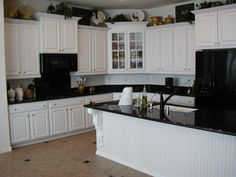 Luxury White Kitchen Cabinets with Black Appliances