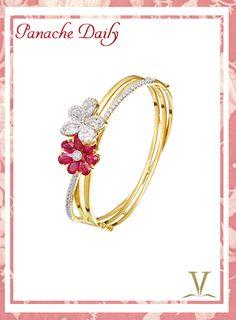 A sweet flower bracelet with under 1 karat of diamonds and 4.5 karats of rubies set in 18 karat yellow gold.